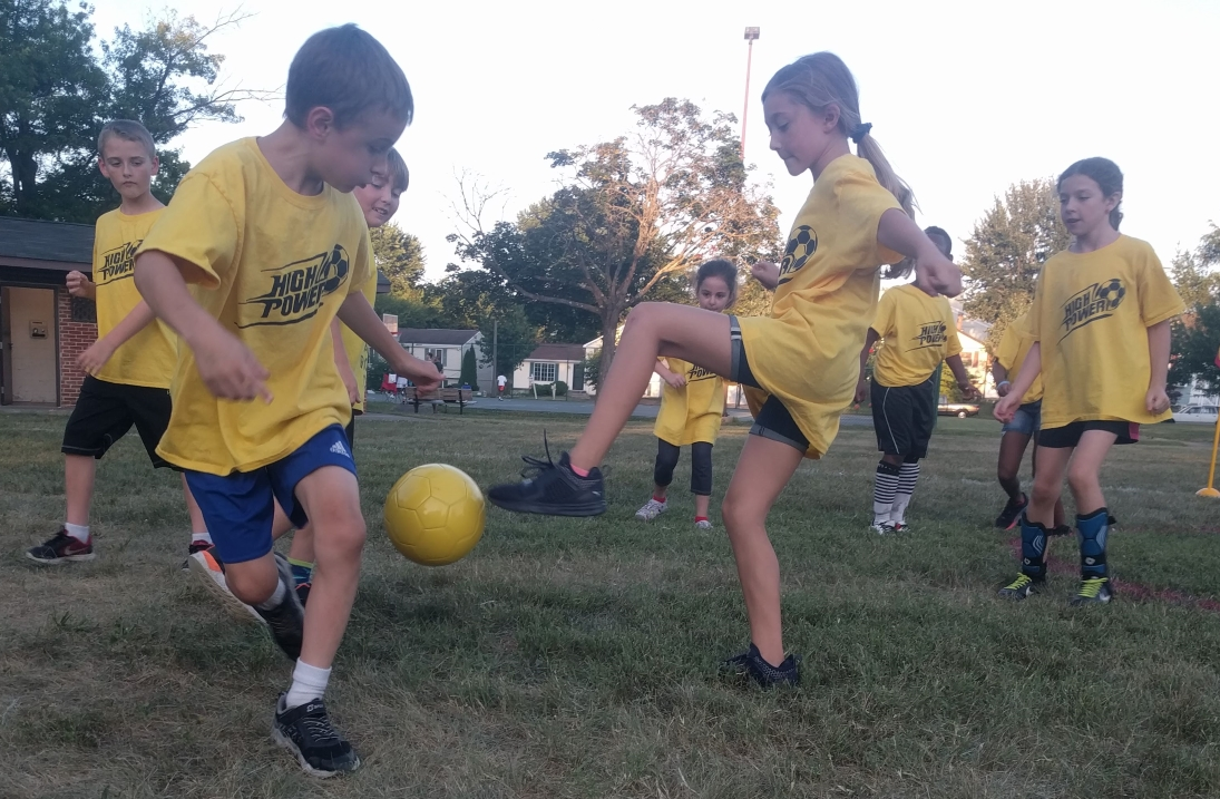 soccer camp kick ball